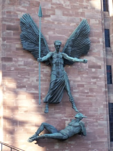 St Michael defeating the devil on the front of Coventry Cathedral