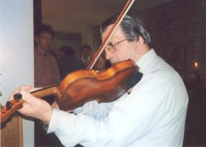 Dad playing the violin - strings tensioned.