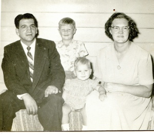 Our family in that kitchen in about 1957. N.B. I was a blond in those days.