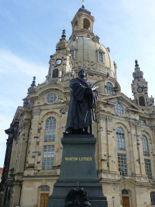 The Frauenkirche fronted by a statue of Martin Luther